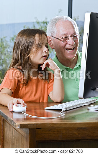 grandfather and granddaughter with computer - csp1621708