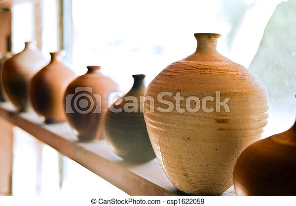 pottery vases on shelf - csp1622059