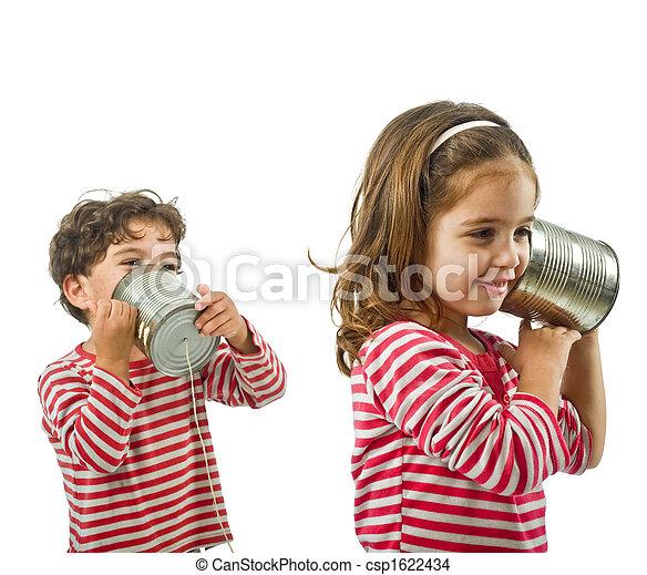 two kids talking on a tin phone - csp1622434