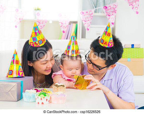 asian family celebrating baby full moon party