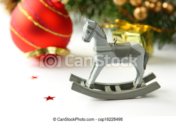 Christmas composition with wooden toy rocking horse - csp16228498