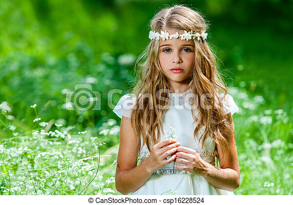Beautiful pre teen in green field. - csp16228524