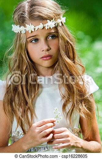 Cute girl in white dress holding flower. - csp16228605
