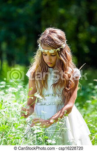 Girl in white dress picking flowers. - csp16228720