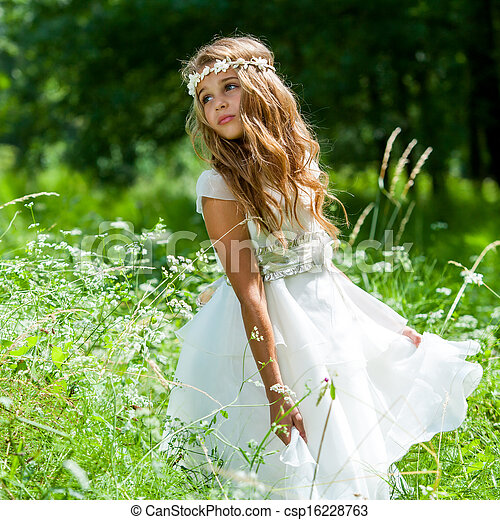 Girl playing with white dress in field. - csp16228763