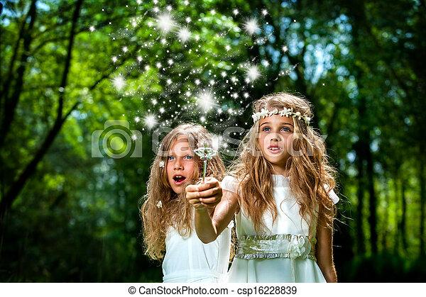 Girls casting magic spells in woods. - csp16228839