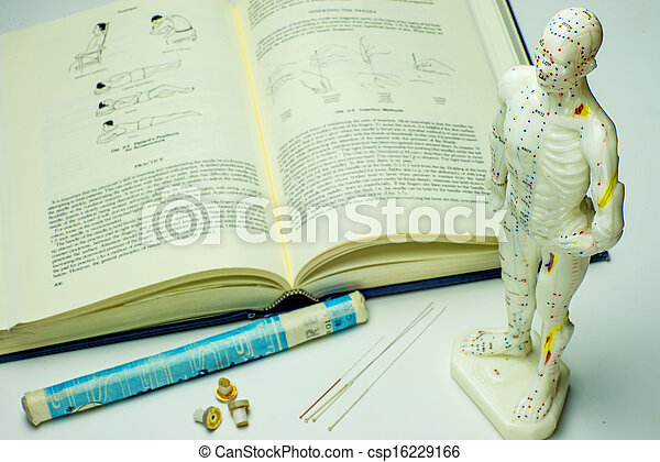 Acupuncture needles and textbook - csp16229166