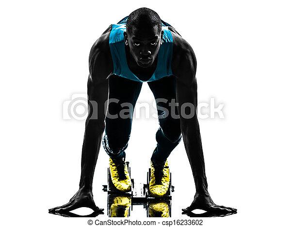 man runner sprinter on starting blocks   silhouette - csp16233602