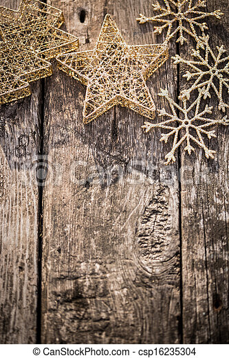 Gold Christmas tree decorations on grunge wood - csp16235304