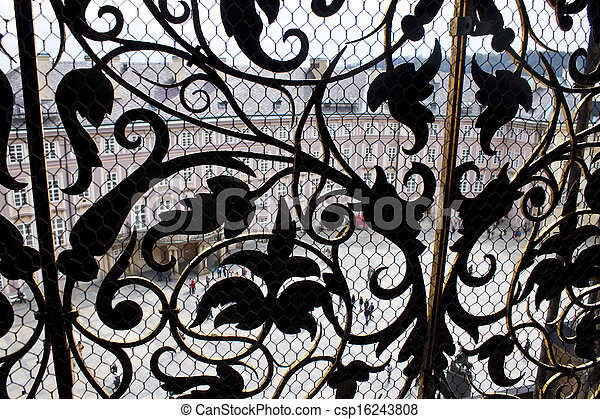Aerial view of the third courtyard of Prague castle through an ornate window. Prague Castle is the biggest castle in the world at about 570 metres in length. - csp16243808