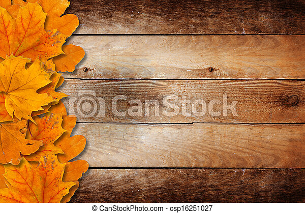 Bright fallen autumn leaves on a wooden background - csp16251027