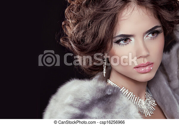 Glamour. Fashion girl Model wearing in Luxury Mink Fur Coat isolated black background. - csp16256966
