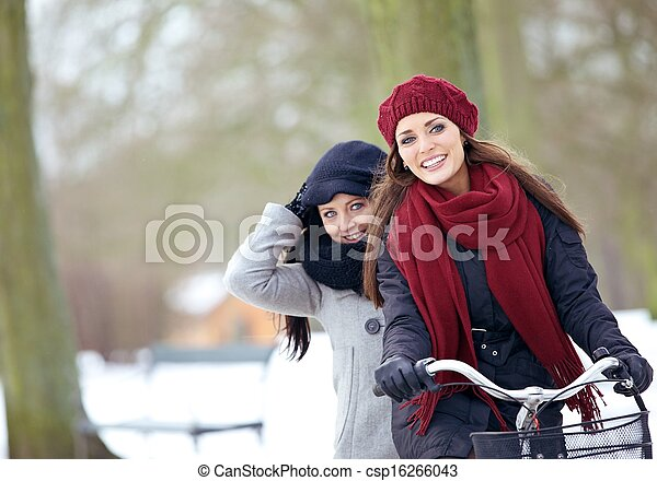 Two Friends Enjoying the Winter Vacation Outdoors - csp16266043