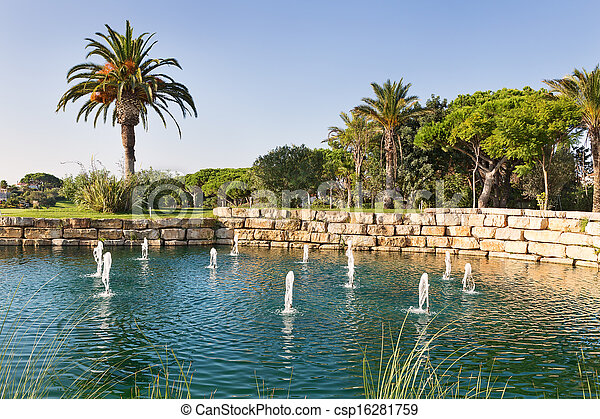 Luxury Fountain Lake in the park golf course in Portugal. - csp16281759