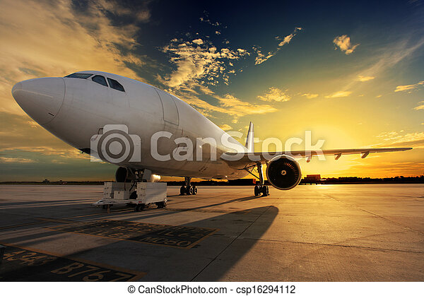 Airplane at sunset - back lit - csp16294112