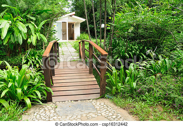 Beautiful house yard and wooden bridges - csp16312442