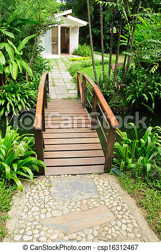Beautiful house yard and wooden bridges - csp16312467