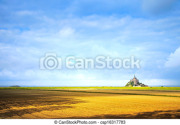 Mont Saint Michel monastery landmark and field. Unesco heritage site. Normandy, France, Europe. - csp16317783