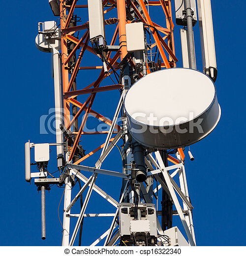 Communications tower with antennas on blue sky - csp16322340