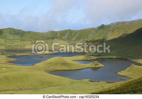 Volcano crater with lake on Azores Portugal - csp16325234