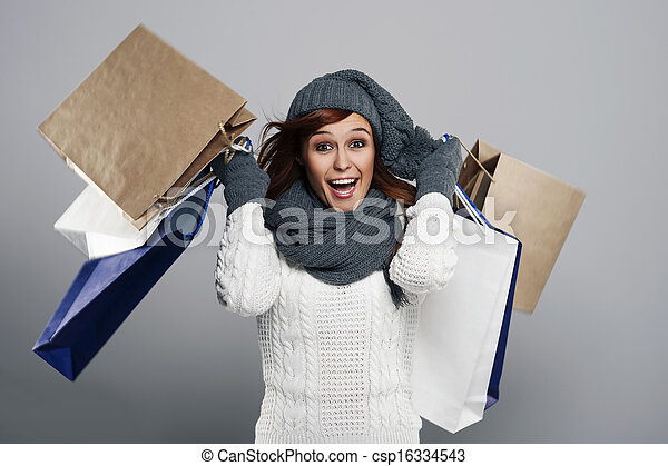 Young excited woman during the winter sale  - csp16334543