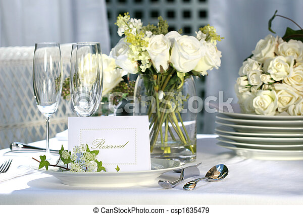 White place card on outdoor wedding table - csp1635479