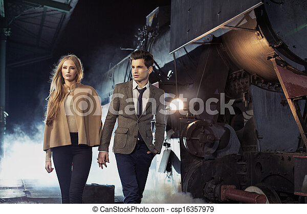 Young couple walking in historic railway station - csp16357979