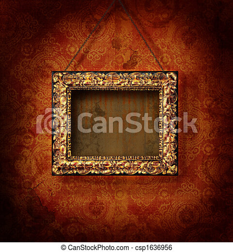 Gilded picture frame on antique wallpaper - csp1636956