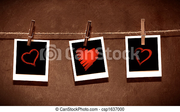 Photo paper attach to rope with clothes spins on grunge  background/ Valentine theme - csp1637000