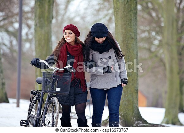 Two Beautiful Women on a Chilly Day at the Park - csp16373767