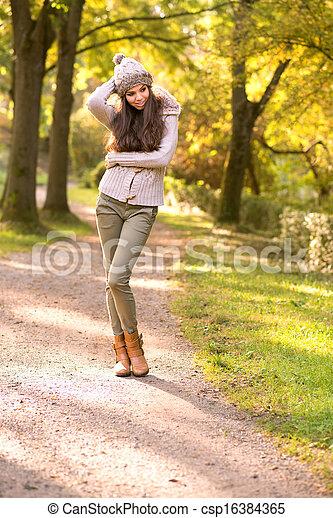 Beautiful girl portrait in the autumn park - csp16384365