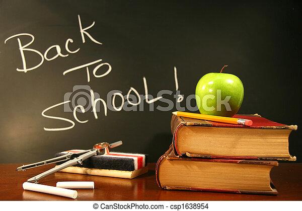School books with apple on desk - csp1638954