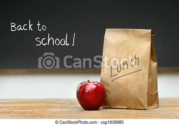 Paper lunch bag on desk - csp1638985
