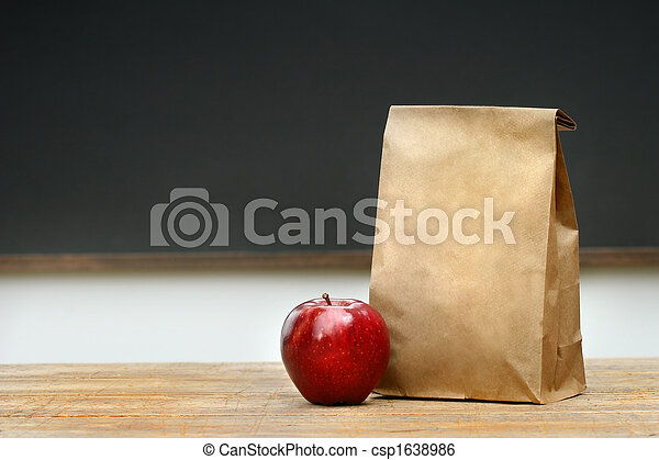 Paper lunch bag on desk  - csp1638986