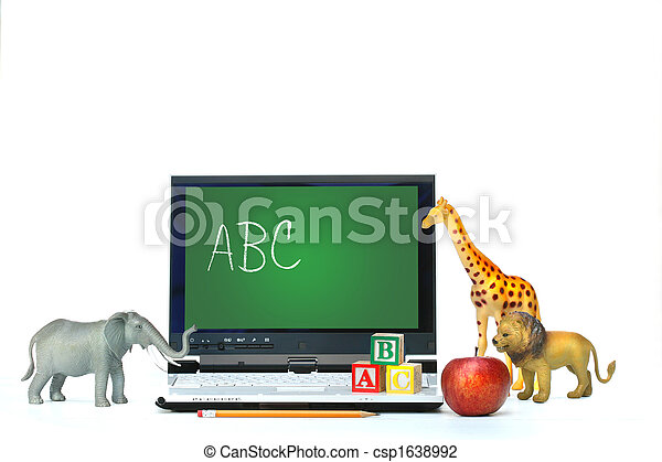 Laptop on desk with toy animals and apple - csp1638992