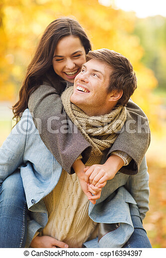 romantic couple playing in the autumn park - csp16394397