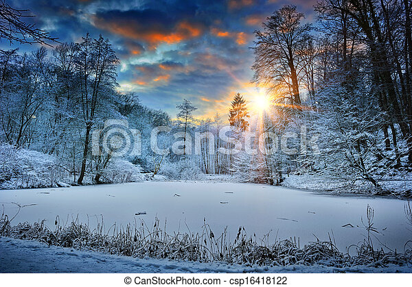 Sunset over winter forest lake - csp16418122