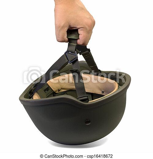 Hand holding military helmet - csp16418672