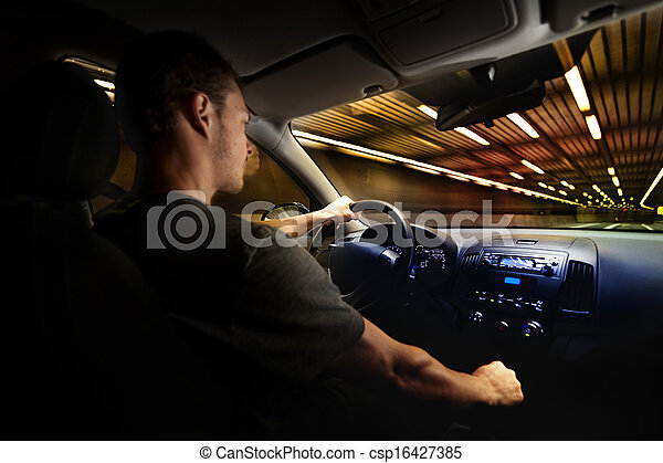 Young Adult Driving Over the Speed Limit in a Tunnel. - csp16427385