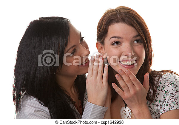 Two young women whisper together - csp1642938
