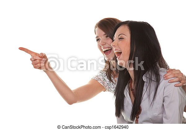 Two young women breaking into laughter - csp1642940