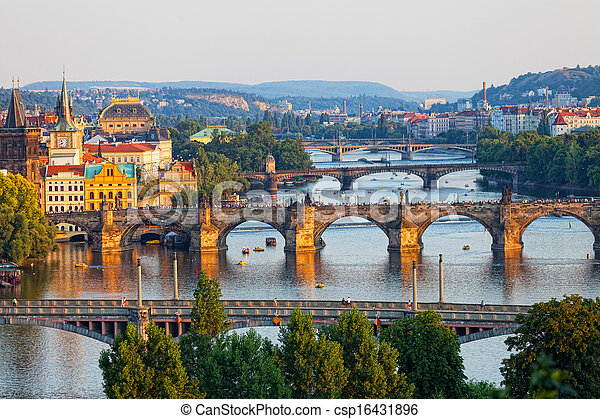 View of the Vltava River and the bridges shined with the sunset sun, Prague, the Czech Republic - csp16431896