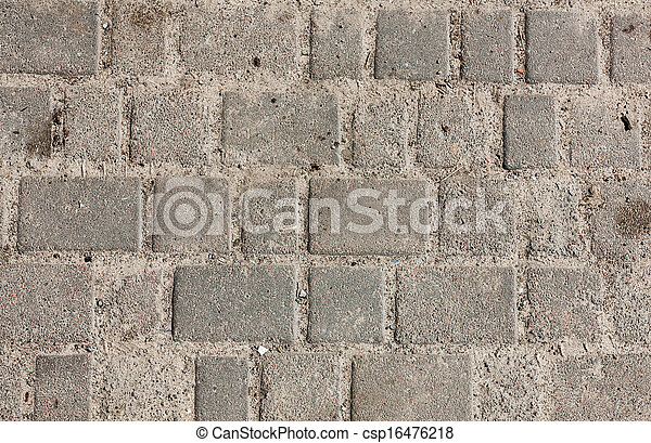 Seamless tileable texture of paving slabs the sand