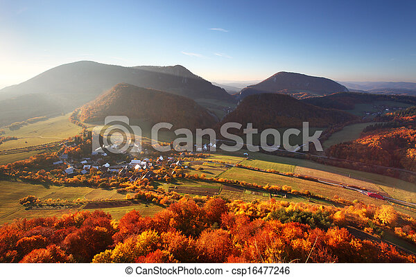 Aerial view on small town - colorful fields and trees in autumn, - csp16477246