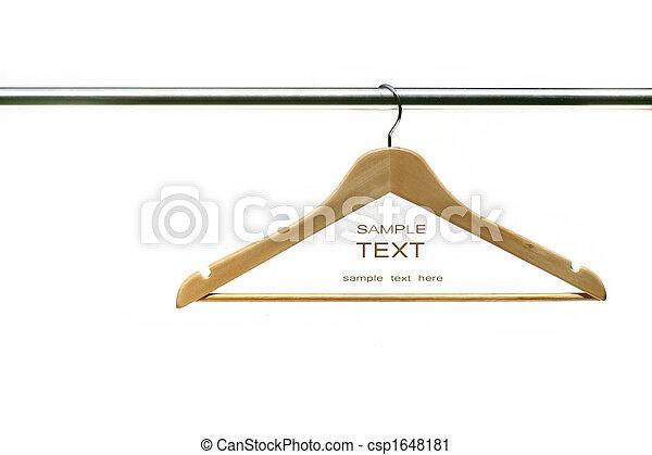 Coat hanger on clothes a rail - csp1648181