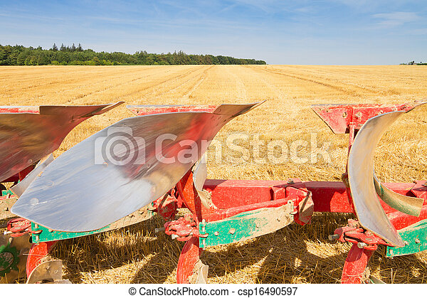 Detail of agriculture plow and stubble field - csp16490597