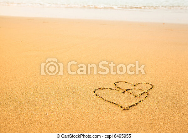 Shape of two hearts of the sea on the beach in Valentine Day. Soft wave of the sea. - csp16495955