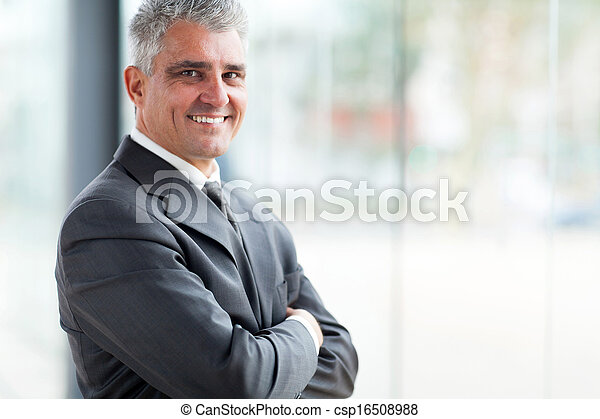 businessman with arms folded looking at the camera