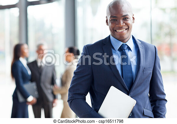 african american businessman with laptop computer in office - csp16511798