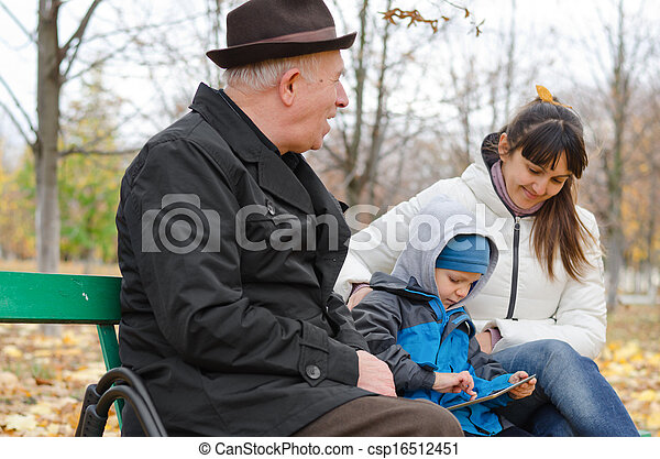Three generations of a family at the park - csp16512451